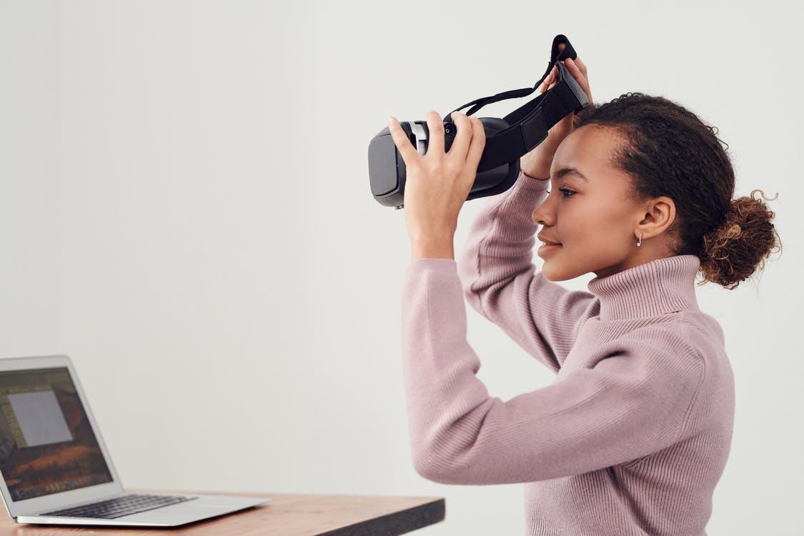 Woman Holding Black Vr Headset