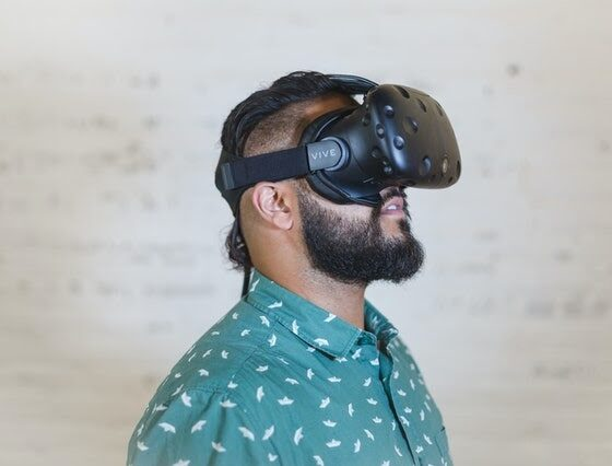 A person wearing a virtual reality goggles Description automatically generated with medium confidence